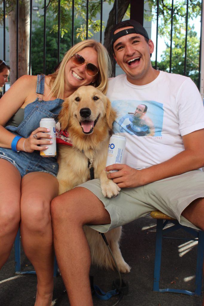 couple with dog at brewery