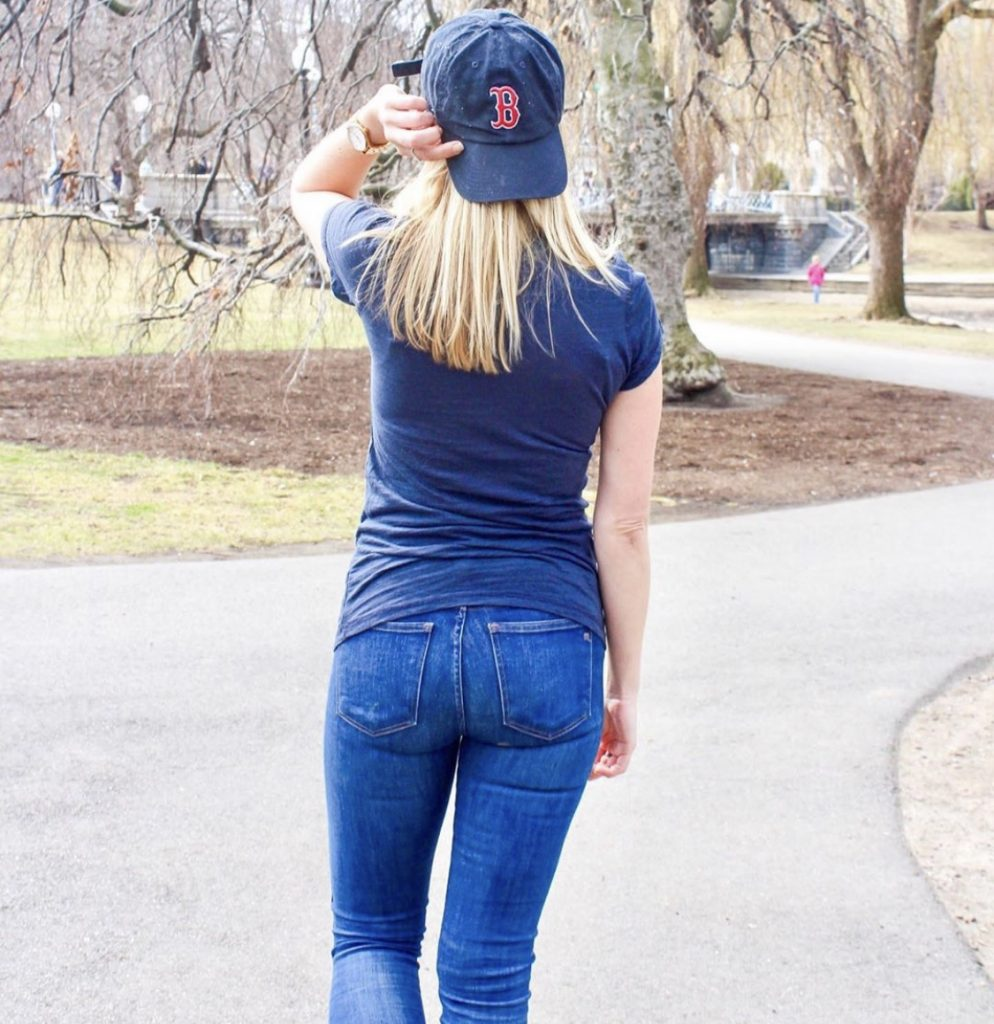 Girl looking towards Fenway Park with a Boston Red Sox hat on