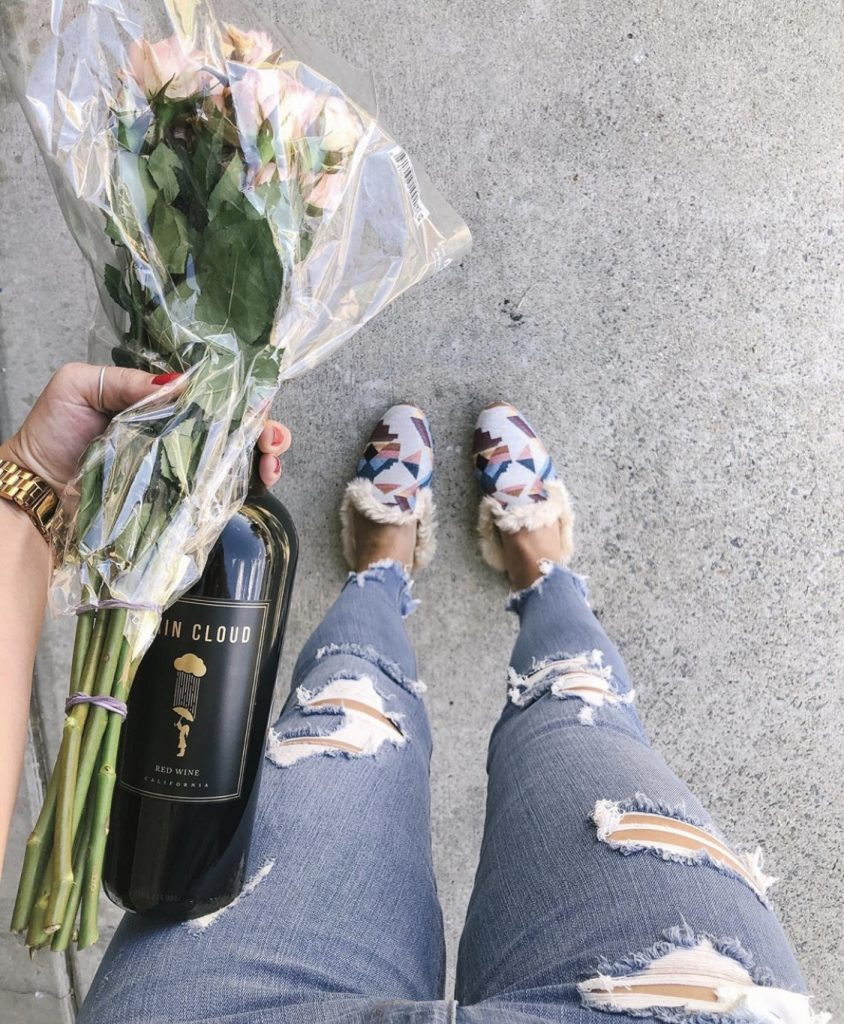 Wine, flowers, & ripped jeans