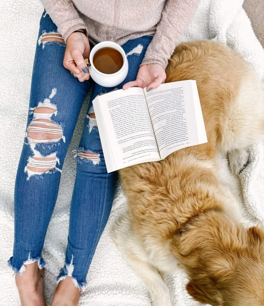 Cozy mornings reading in bed with coffee