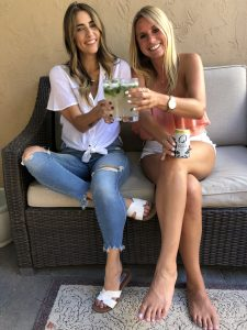 Two girls enjoying a cocktail together